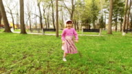 Girl is running in the park. Slow motion video