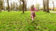 Girl is running in the park. Slow motion. video