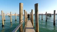 Girl is standing on the boats wharf, Venice, Italy video