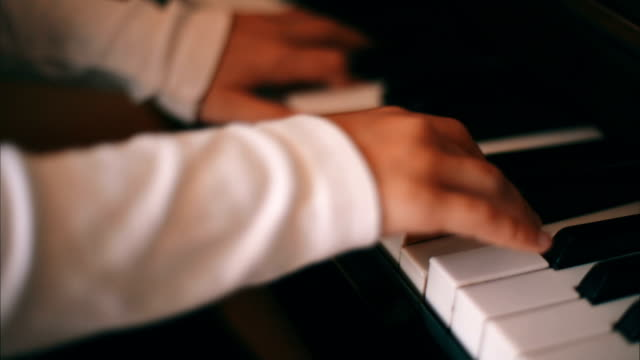 Girl is Studying  a Play on a Piano video
