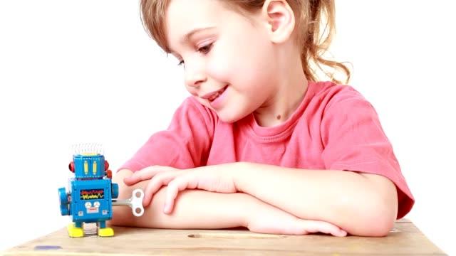 Girl is watching going forward clockwork robot video