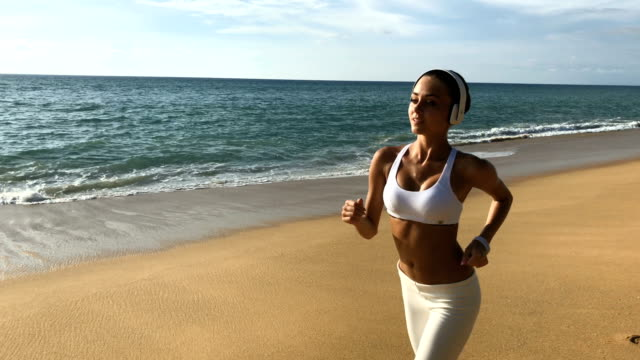 Girl Jogging On The Beach video