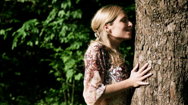 Girl kissing tree video