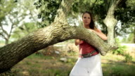 Girl Leaning on Tree Smiling and Looking video