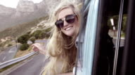 Girl leaning out of car window video
