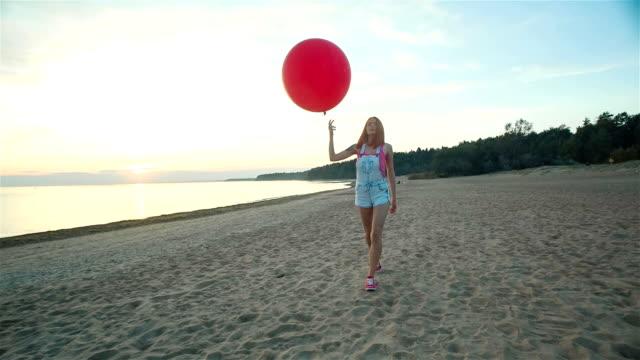 Girl Lets Go A Balloon On The Beach video