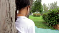 Girl listen to music from Smart Phone,Dolly shot video