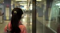 girl listening music in subway video
