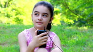 Girl listening to music on a smartphone video