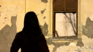 Girl looking at an Old Abandoned House video