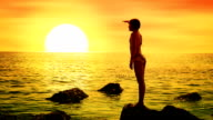 Girl looking at sea sunset video