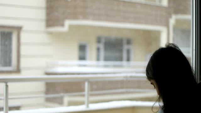 girl looking through snowy video