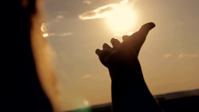 Girl looks at the sun through her hand video