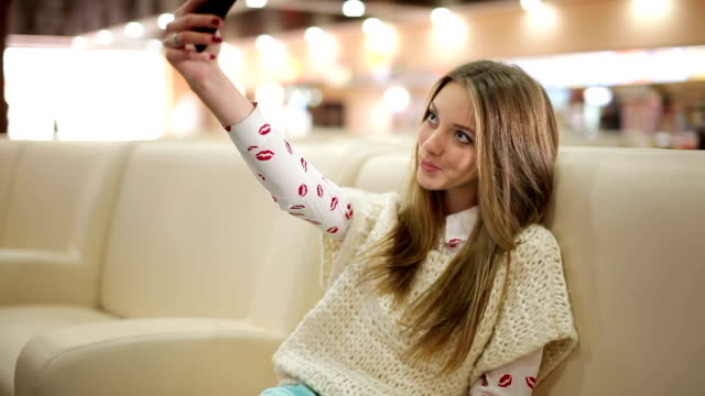 Girl make selfie and send sms video