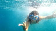 Girl making faces underwater video