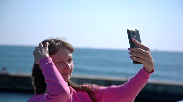 Girl making selfie at the beach video