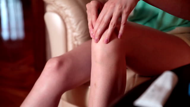 Girl massaging sore knee video