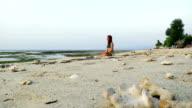 Girl meditating in Gili Air at sunset video