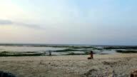 Girl meditating on seashore in lotus position video