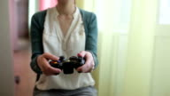Girl moves analog stick of the gamepad video