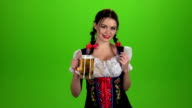 Girl Oktoberfest sexually attracts and licks his lips. Green screen video