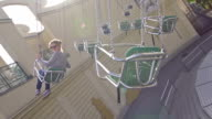 Girl on chairoplane in an amusement park video