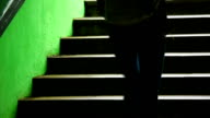 Girl on Dark Green Staircase video