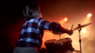 Girl on drums at the end of the song video