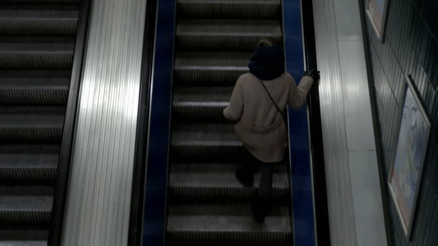 Girl on escalator from top view video