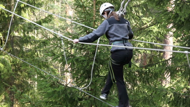 Girl on High Ropes Course in trees video