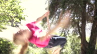 Girl On Rope Swing In Garden video