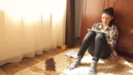Girl on the floor using a digital tablet for studying at home. video