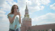 Girl on the red square with your phone video