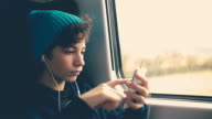 Girl on Train using smartphone video