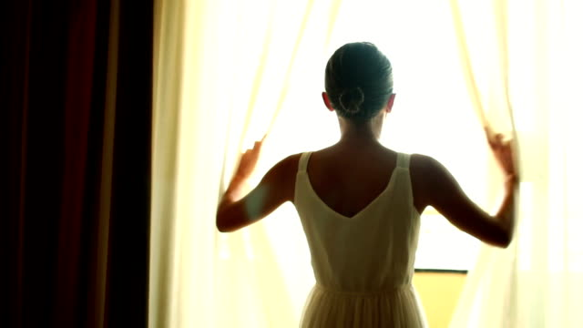 Girl opens the curtains video