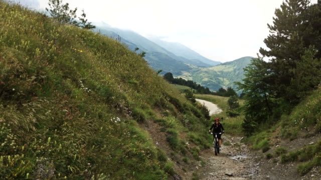 Girl Pedalling Mountain Bike on a White Road video