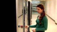 Girl picking item from Vending Machine video