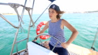 Girl Pirate at the helm of yacht cruise video