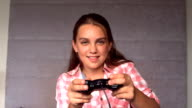 Girl playing at video game video