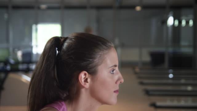 Girl playing Bowling video