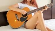 girl playing guitar video