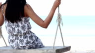 Girl Playing on Swing video