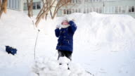 girl playing outdoors in winter. Children throw snowballs video