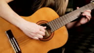 Girl playing the guitar video