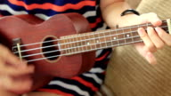 girl playing ukulele video