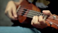 Girl playing ukulele,Close-up video