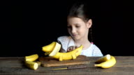 Girl playing with a toy dog made from banana video