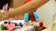 Girl playing with dolls video
