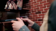 Girl plays shooter video game on console video