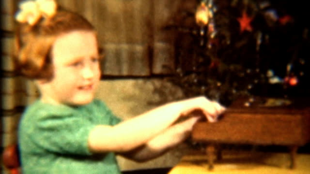 Girl Plays Toy Piano By Christmas Tree (1942 Vintage 8mm) video